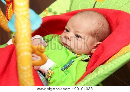 Serious Newborn In The Rocking Chair