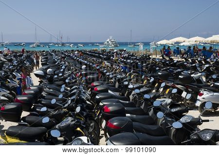 Many Scooters Parked Near The Beach