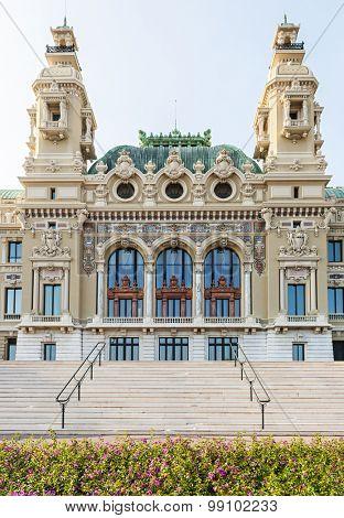 Sea facing facade of Monte Carlo casino building in Monaco viewed from gardens at seaside