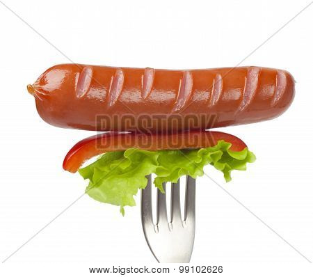 Close up of sausage and fork isolated on white background