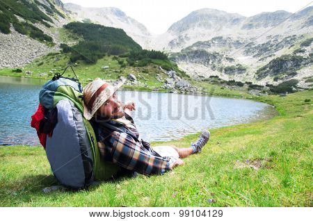 Traveller enjoying the view and relaxing at mountain site.