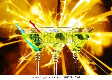 Cocktails in martini glasses on bright background