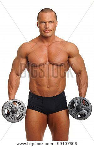 Muscular man exercises