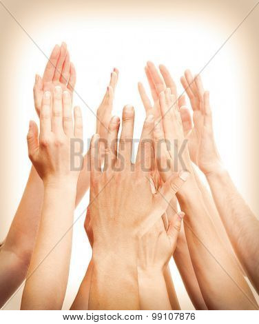 People's hands together on light background
