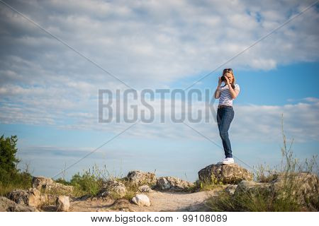 Woman photographing in Stone Forest (Pobiti Kamani), Bulgaria