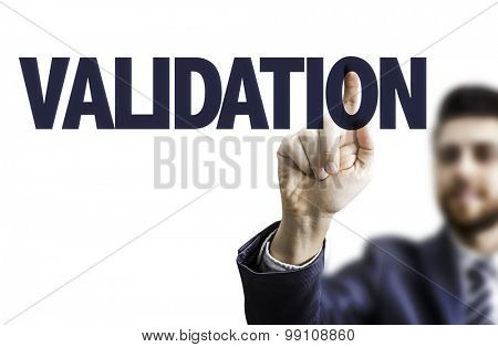 Business man pointing the text: Validation