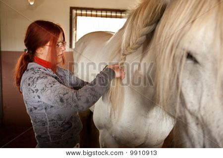 Woman Prepare Horse For Riding