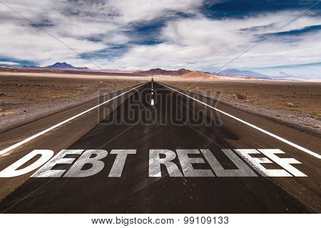 Debt Relief written on desert road