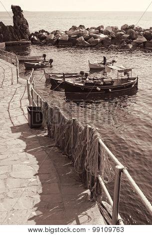 Italy. Cinque Terre. Boats In Manarola Village. In Sepia Toned. Retro Style