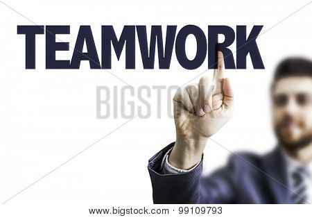 Business man pointing the text: Teamwork