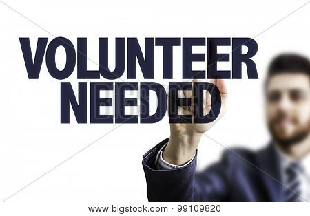 Business man pointing the text: Volunteer Needed