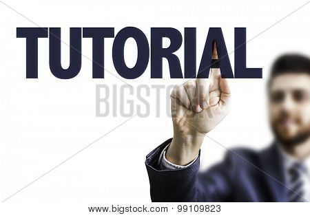 Business man pointing the text: Tutorial
