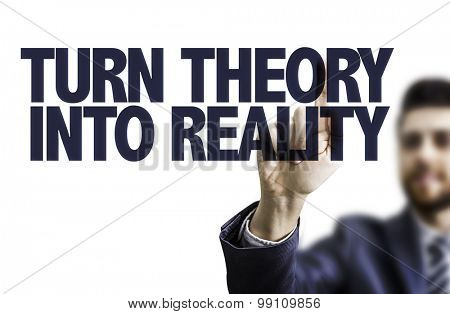 Business man pointing the text: Turn Theory Into Reality