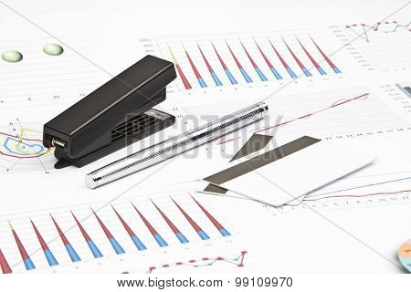 Business Still-life Of A Charts, Graphs, Credit Cards, Stapler