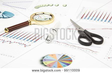 Business Still-life Of A Charts, Graphs, Pen, Magnifier, Scissors