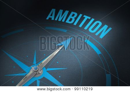 The word ambition and compass against grey