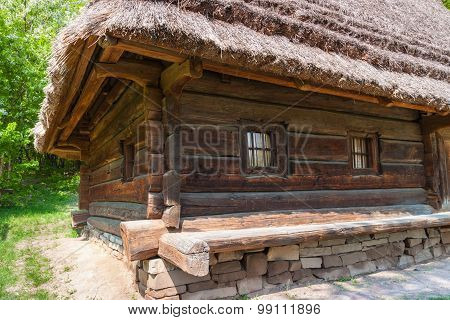 Ukrainian Ancient Wooden Farmhouse With  Thatched Roof In  Forest.