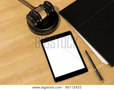 Wooden Judges Gavel And Tablet Computer On The Wooden Background