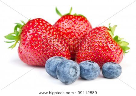 Strawberries and blueberries on white background