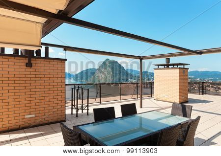 beautiful veranda with panoramic views, table and chairs