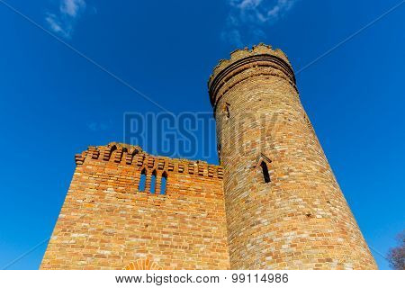 ruins of old tower on blue sky background