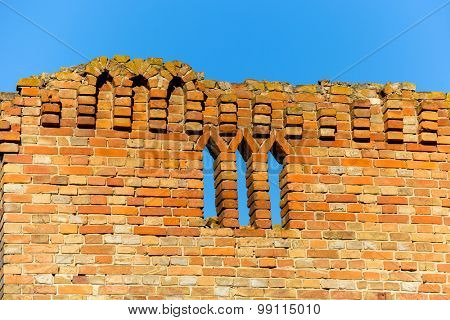 Old castle wall against blue sky background