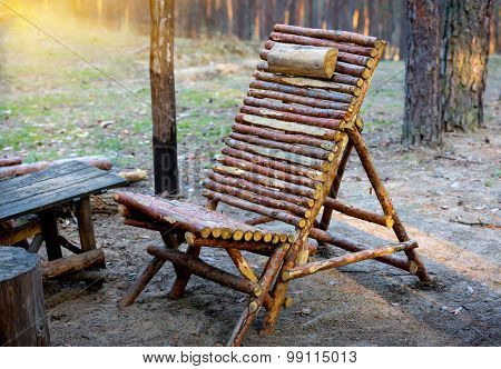 abstract wooden chair in pine forest camp