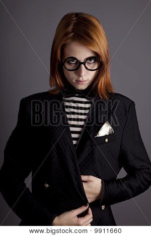 Portrait of fashion girl in jacket and glasses.