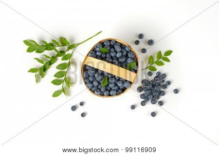 overhead view of freshly gathered blueberries in the woven  basket