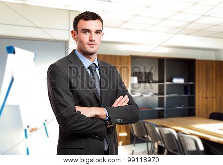 Portrait of a young handsome businessman in a meeting room