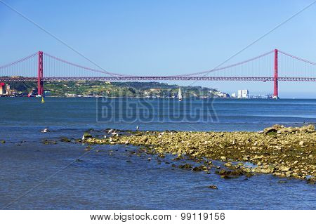 Red bridge over the Tagus river in Lisbon, Portugal