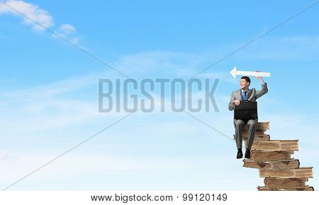 Businessman with signboard
