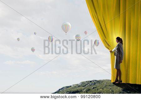 Woman opening curatin