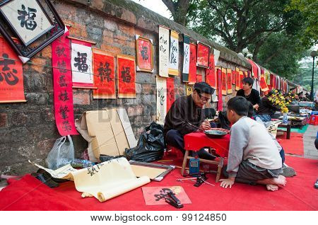 Old master is writing ancient letter for everyone in lunar new year in Hanoi, Vi