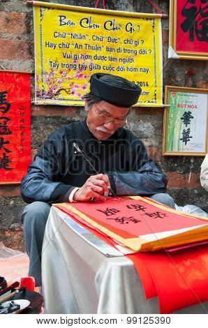 Old master is writing ancient letter for everyone in lunar new year in Hanoi, Vietnam