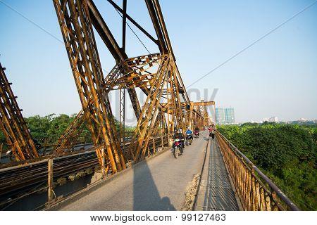 People ride motorbike in Long Bien bridge