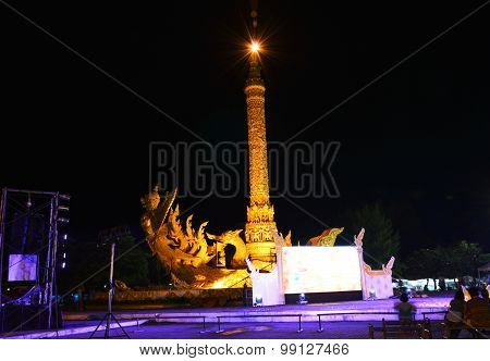Garuda sculpture on big candle used in raining season