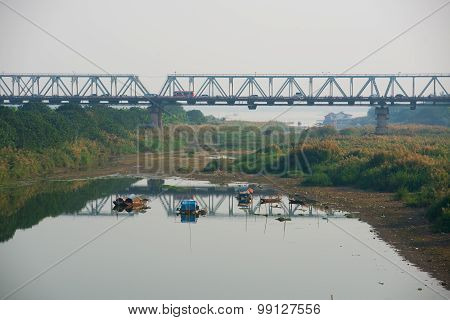 Red river with boats in Hanoi, Vietnam