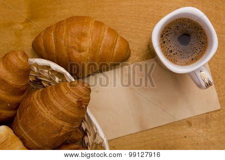 Cup Of Morning Coffee And Croissants