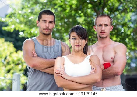 Portrait of extreme athletes looking at camera with arms crossed in the city