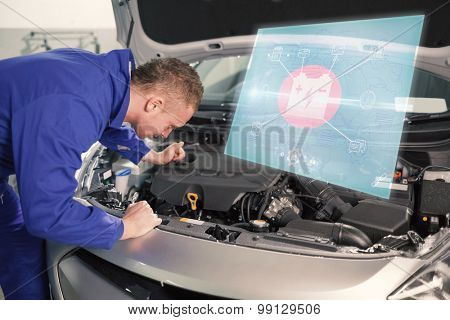Engineering interface against mechanic looking at an engine of car