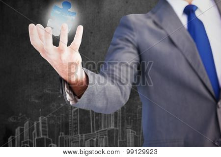 Businessman presenting with his hands against bright blue sky over clouds
