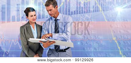 Business team looking at folder against stocks and shares