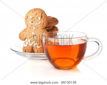 Glass cup of black tea with homemade cookies and gingerbread man. Isolated on white background