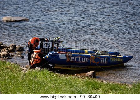 ORESHEK FORTRESS, LENINGRAD OBLAST, RUSSIA - AUGUST 15, 2015: Athletes after the fist stage of the River marathon Oreshek Fortress race. This international motorboat competitions is held since 2003
