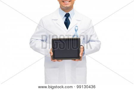 healthcare, people and medicine concept - close up of smiling male doctor in white coat with sky blue prostate cancer awareness ribbon holding tablet pc computer