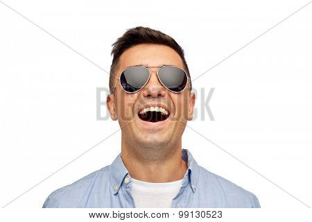 summer, accessories, style and people concept - face of smiling middle aged latin man in shirt and sunglasses