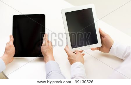business, people, technology, advertisement and teamwork concept - close up of businessman hands with tablet pc computer blank screens at office