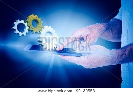A man using tablet computer against blue background with vignette