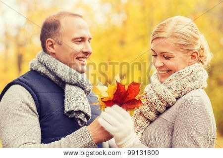 love, relationship, family and people concept - smiling couple in autumn park